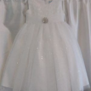 White Sparkly Dress with Silver Brooche on Waist
